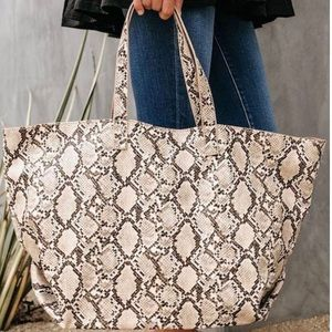 Urban expressions all over snakeskin tote